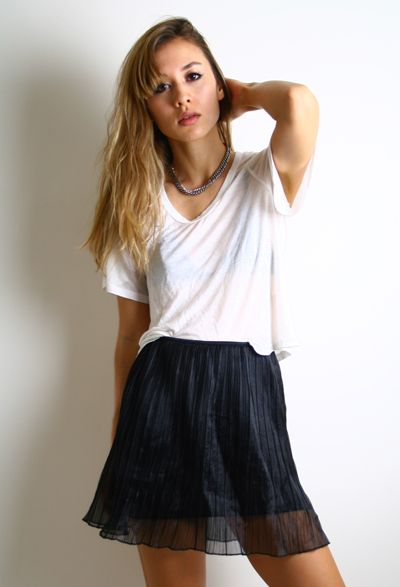 Meara Skirt: High waisted black sheer pleated miniskirt with full lining.